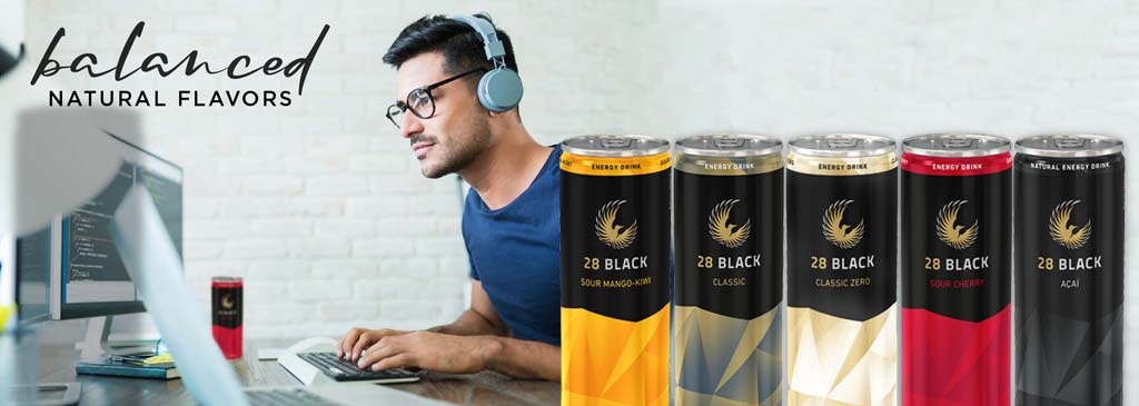 Image of a young professional at his computer doing an online focus group testing the 28 Black Energy Drink Products