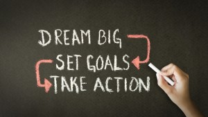 """Chalkboard with the words """"Dream Big Set Goals Take Action"""""""